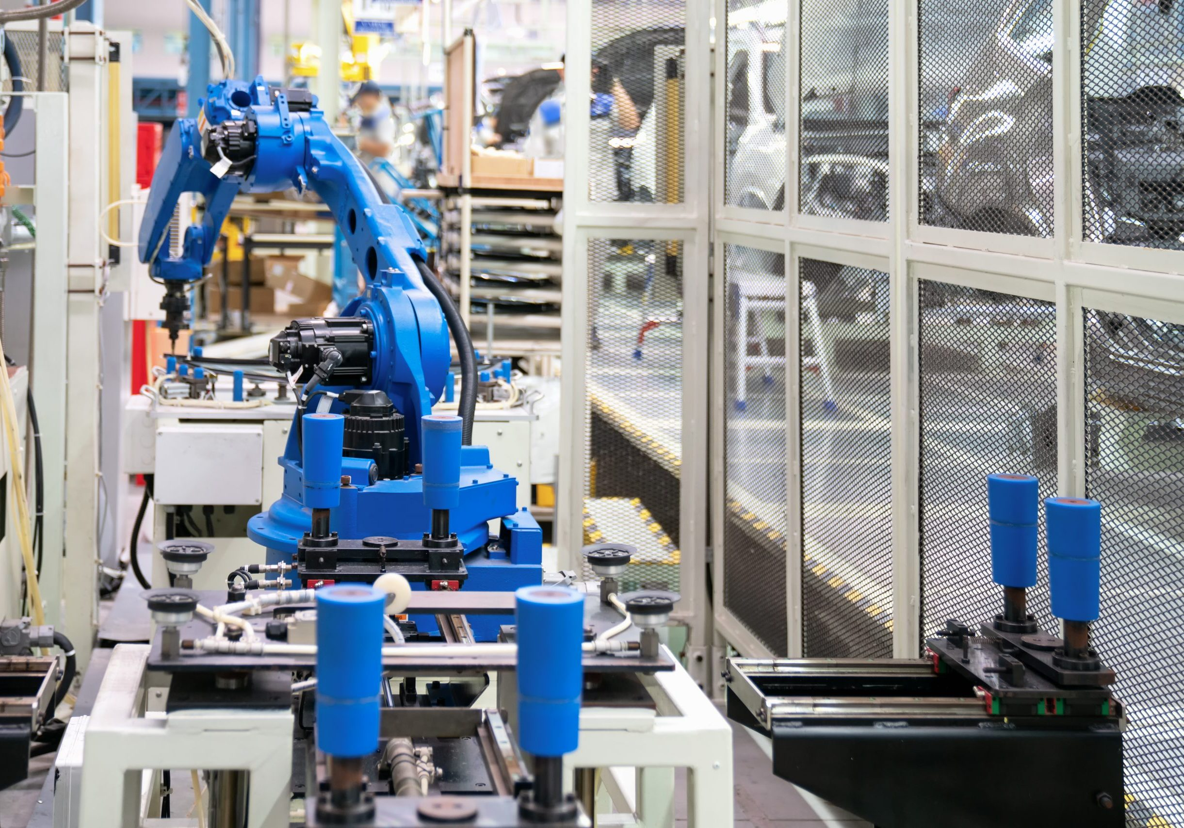 Automatic robot glass sealing in smart manufacturing factory 4.0 in the process of car manufacturing.Automation robotic arm working in operation machine zone in factory, Robot using in industrial manufacturing .