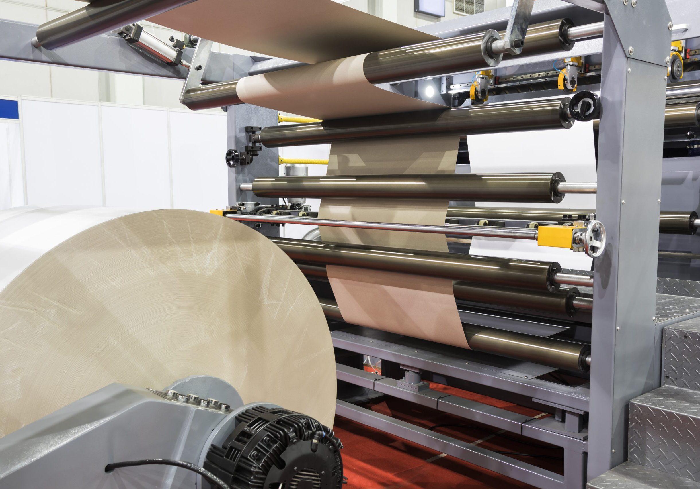 roll of white paper in modern paper cutting machine